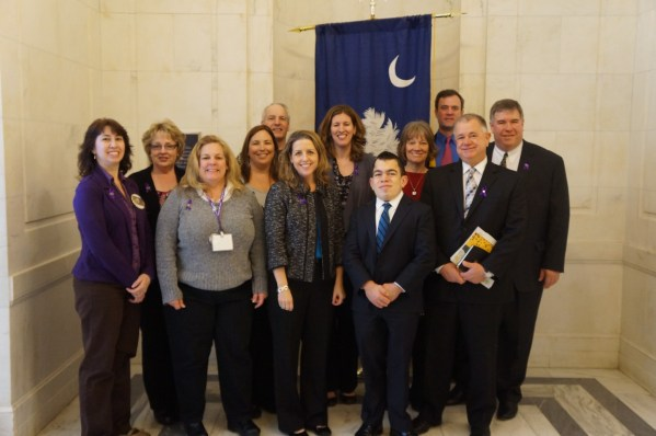 Sen Graham office group pic flag